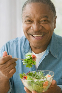 Man enjoying cholesterol-fighting salad