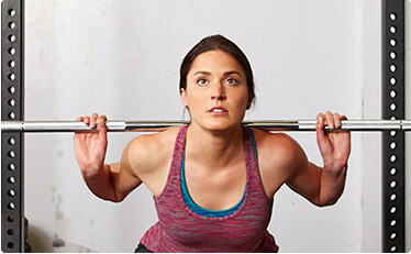 Woman lifting weights during high intensity workout
