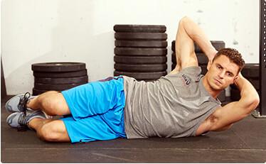 Man doing situps during medium intensity workout